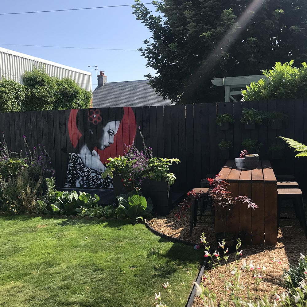 A garden in Prestwick gets the Urban Punkz effect with an Urban Chic mural in the garden, creating a stunning focal point from all viewpoints.